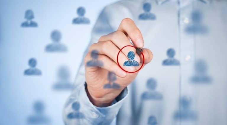 Man circles target audience for automotive marketing